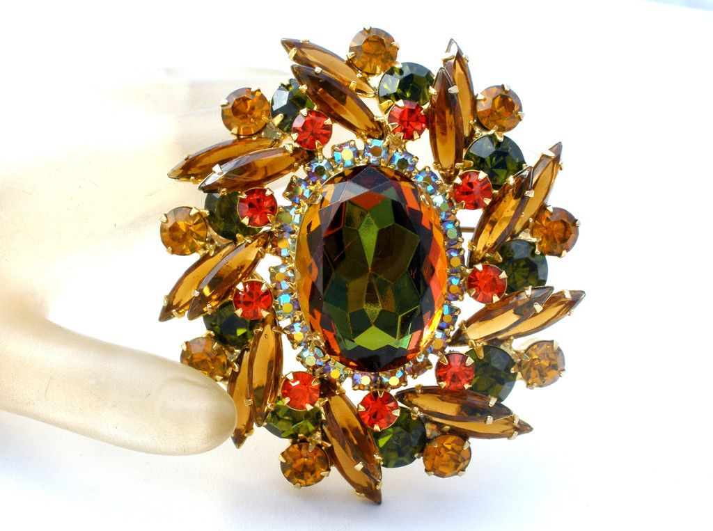 D & E for Juliana Book Piece - This is a large watermelon brooch/pin with topaz, orange and green rhinestones. The center stone is framed with aurora borelis chatons. This brooch is layered with all p