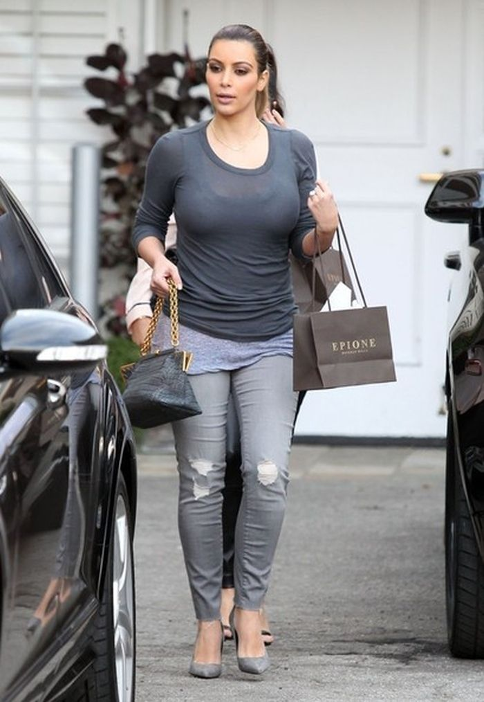 Kim loves her grey jeans kim kardashian in grey skinny for Kim kardashian henley shirt