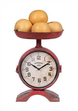 """Our Vintage Red Scale Clock is a beautiful pop of color! Add this rustic element to your kitchen, it is a perfect conversation piece! - 10""""L x 14""""H Metal 2-Sided Scale Shaped Clock, - Red - (Requires"""