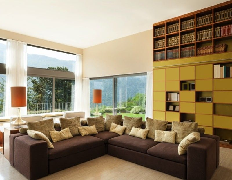Modern Living Room With Large Comfortable Divan And Extensive Full Height  Bookcase And Display Cabinet