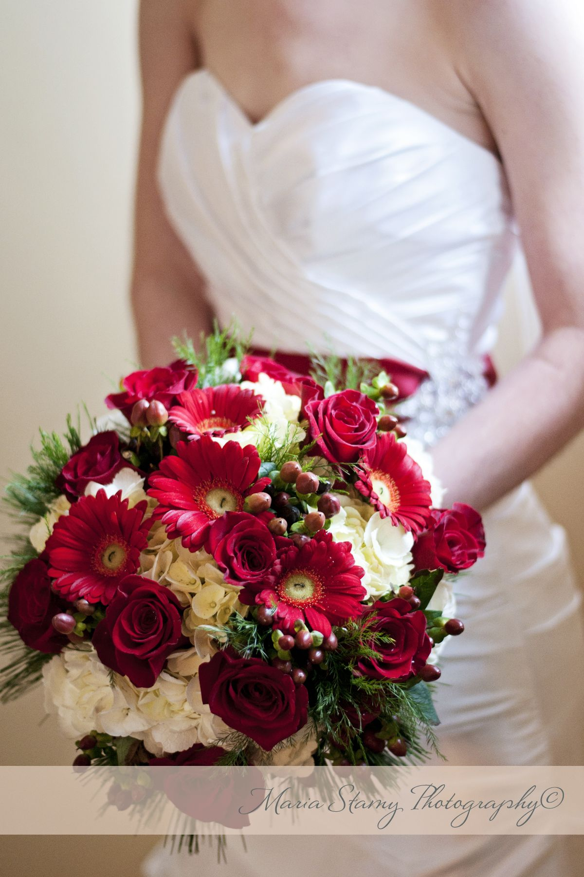 Deep reds and whites for this winter white Christmas wedding boquet