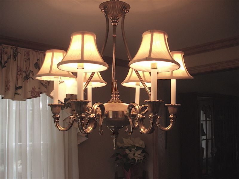 These were very well made candle light lamp shades on a beautiful brass  chandelier. Description