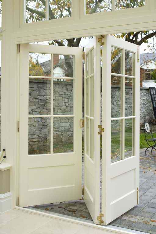 Triple French Doors Accordion Style Open To Outside From Family