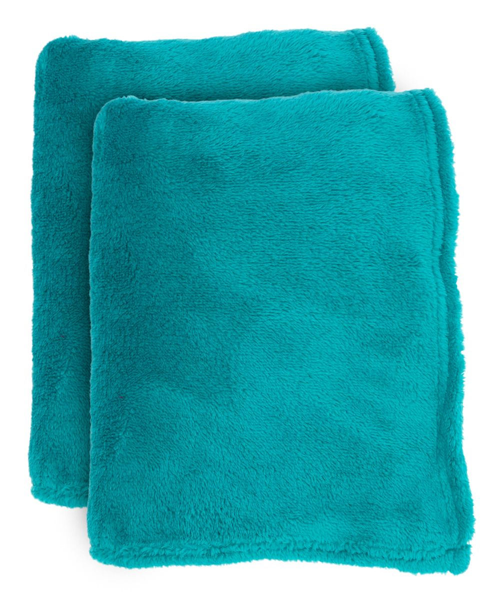 Teal Fleece Throw - Set of Two. . ...  J&M Home Fashions. . ...  $17.99 $30.00  . : Product Description:  Add a pop of colorful panache and fuzzy comfort to the nap game with these plush fleece throws.      Includes two throws  .     50'' x 60''  .     100% polyester  .     Machine wash; tumble dry  .     Imported