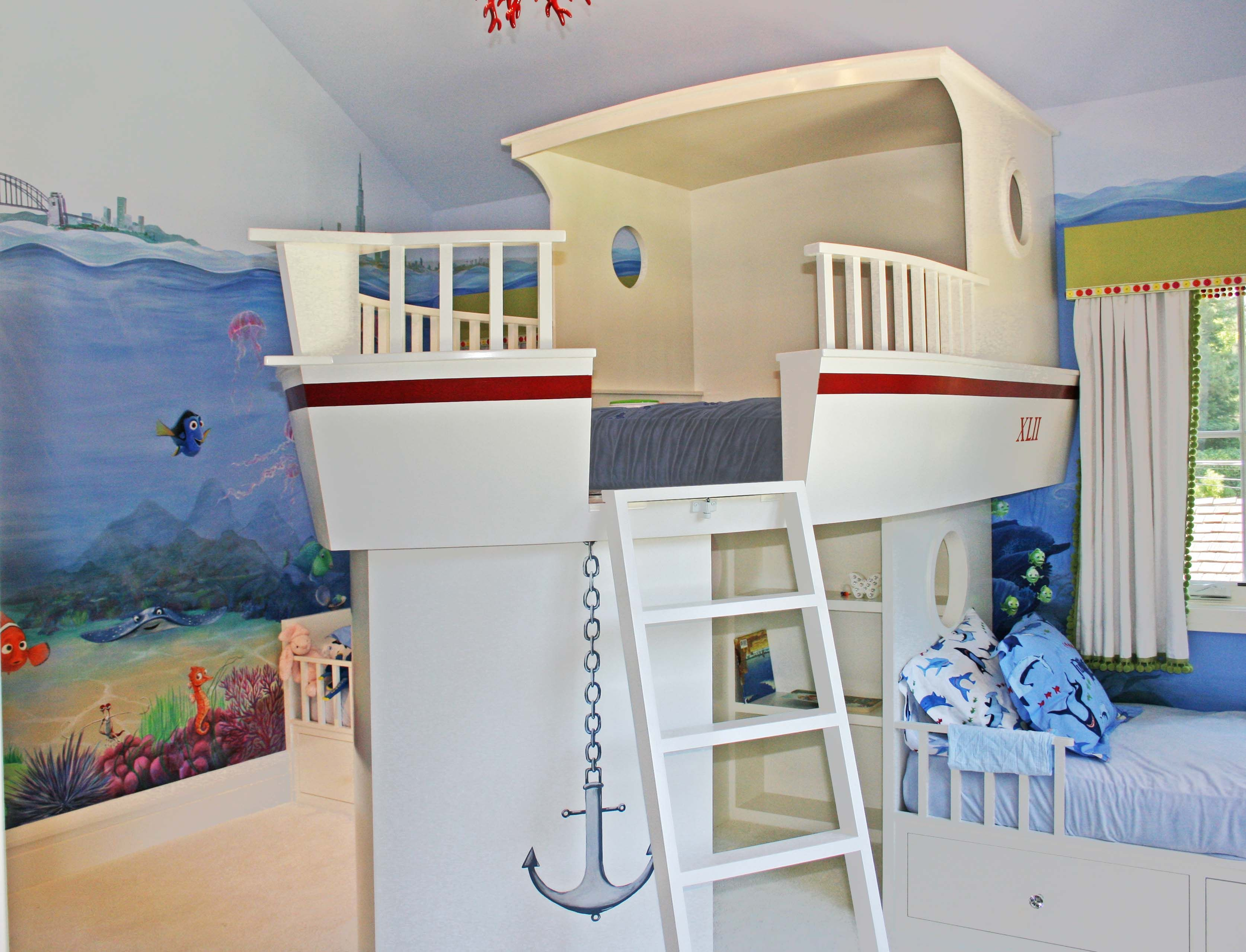 Custom boat bed in this family napping/playroom with