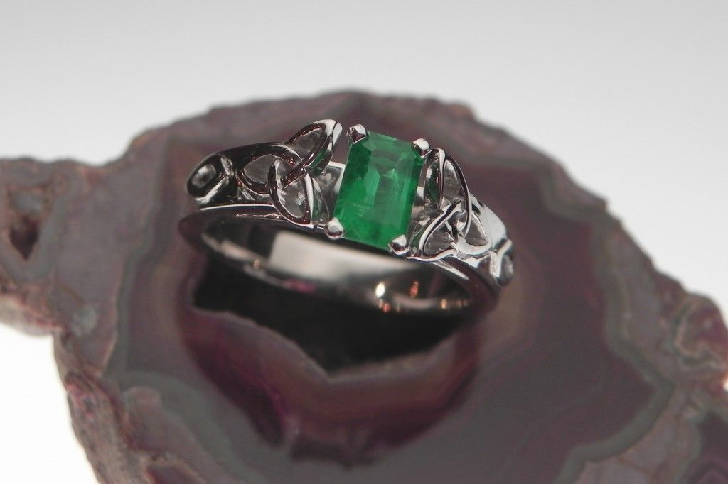 This custom designed engagement ring features handcrafted Celtic