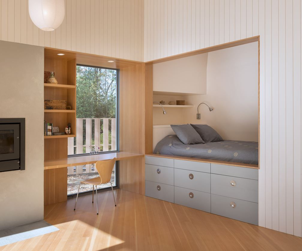 Urban loft bedroom  Cottage In Woods by six Architecture a cottage in the woods for
