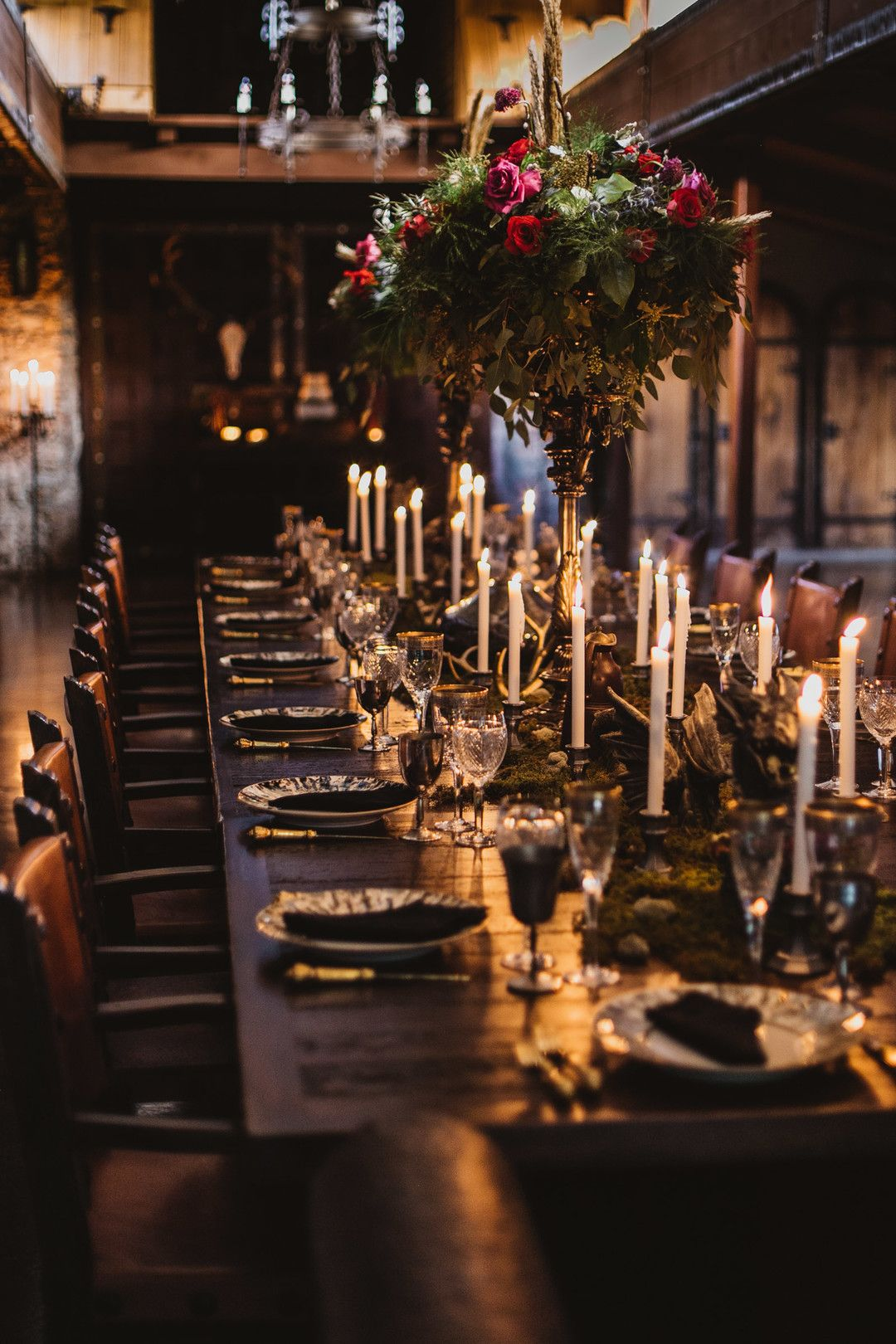 Moody Game of Thrones Themed Wedding Reception with Elevated Centerpieces and Gold & Black Details. Photo by Lara Rose Photography.