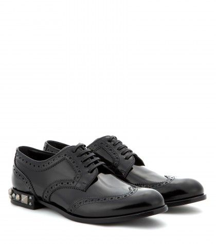 An embellished heel and a glossy, polished finish make Dolce & Gabbana's black leather brogues a dandy choice after dark. Choose them with bare legs and heightened hemlines to really show them off.