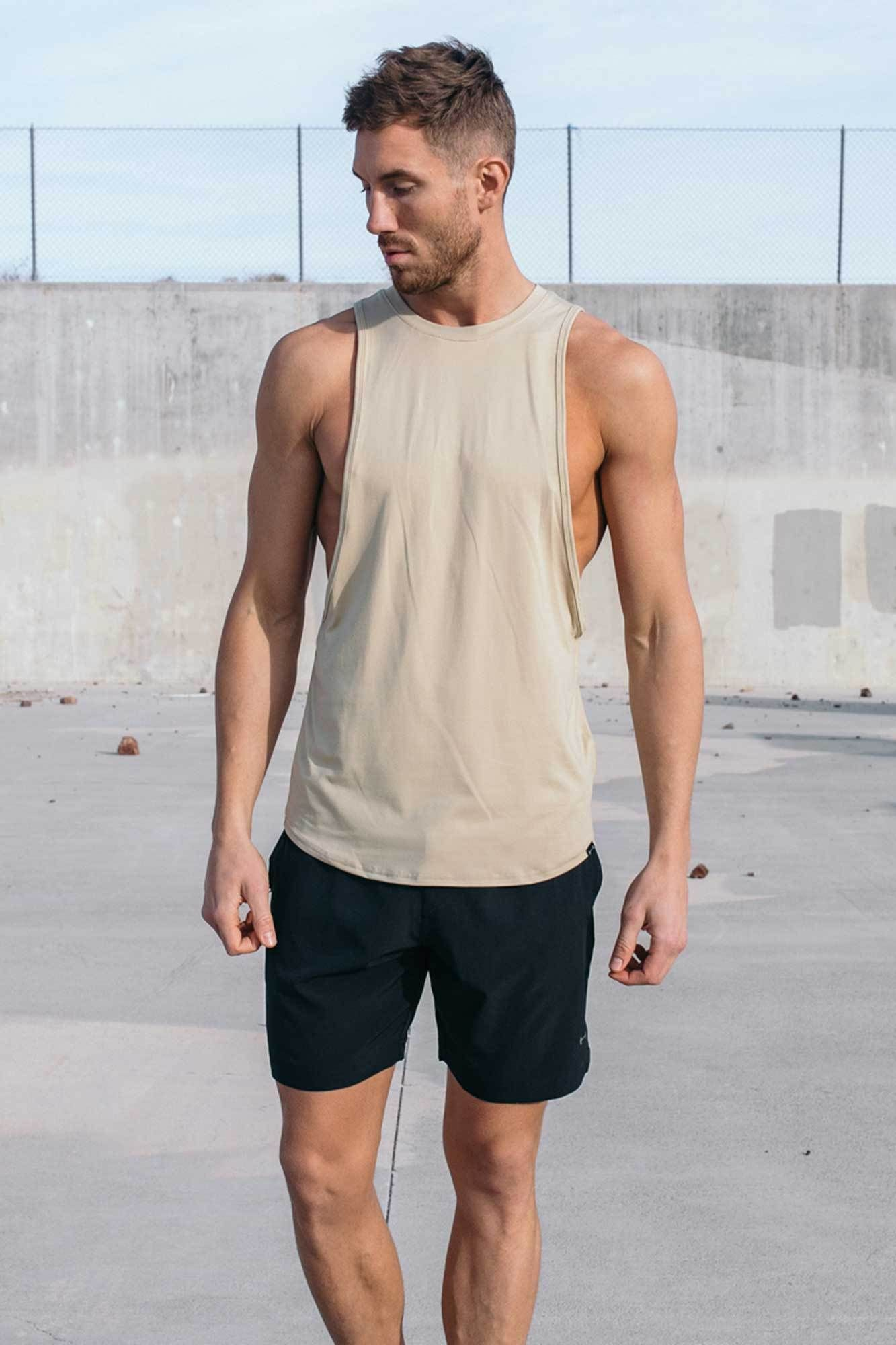 6a20d8b30fefdf WHY WE MADE THIS The Vented Drop Tank pushes the fit of the standard tank  top to the next level. With wide and low arm openings