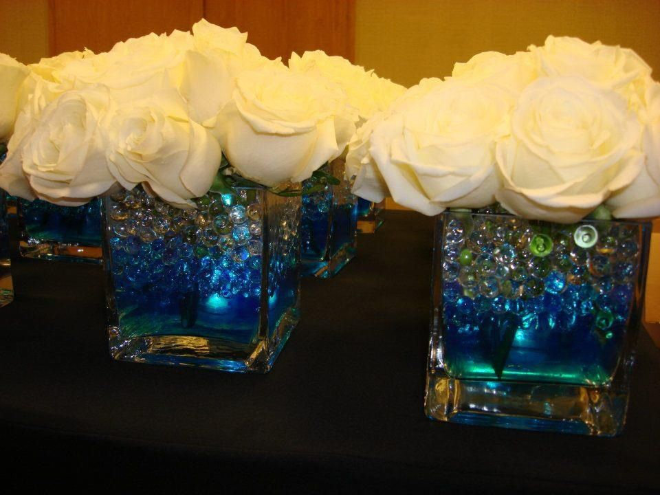 Glowing Centerpiece For A Wedding Square Vase Filled With Clear And Blue Gel Balls Led Light