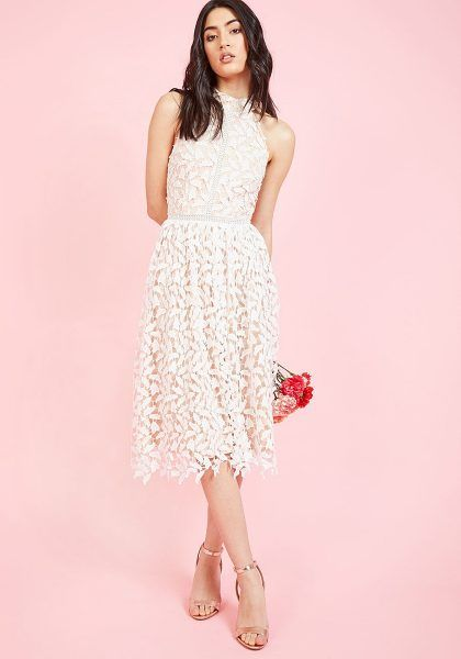 45fce9cc2ff woman in sleeveless lace bridal shower dress on pink background
