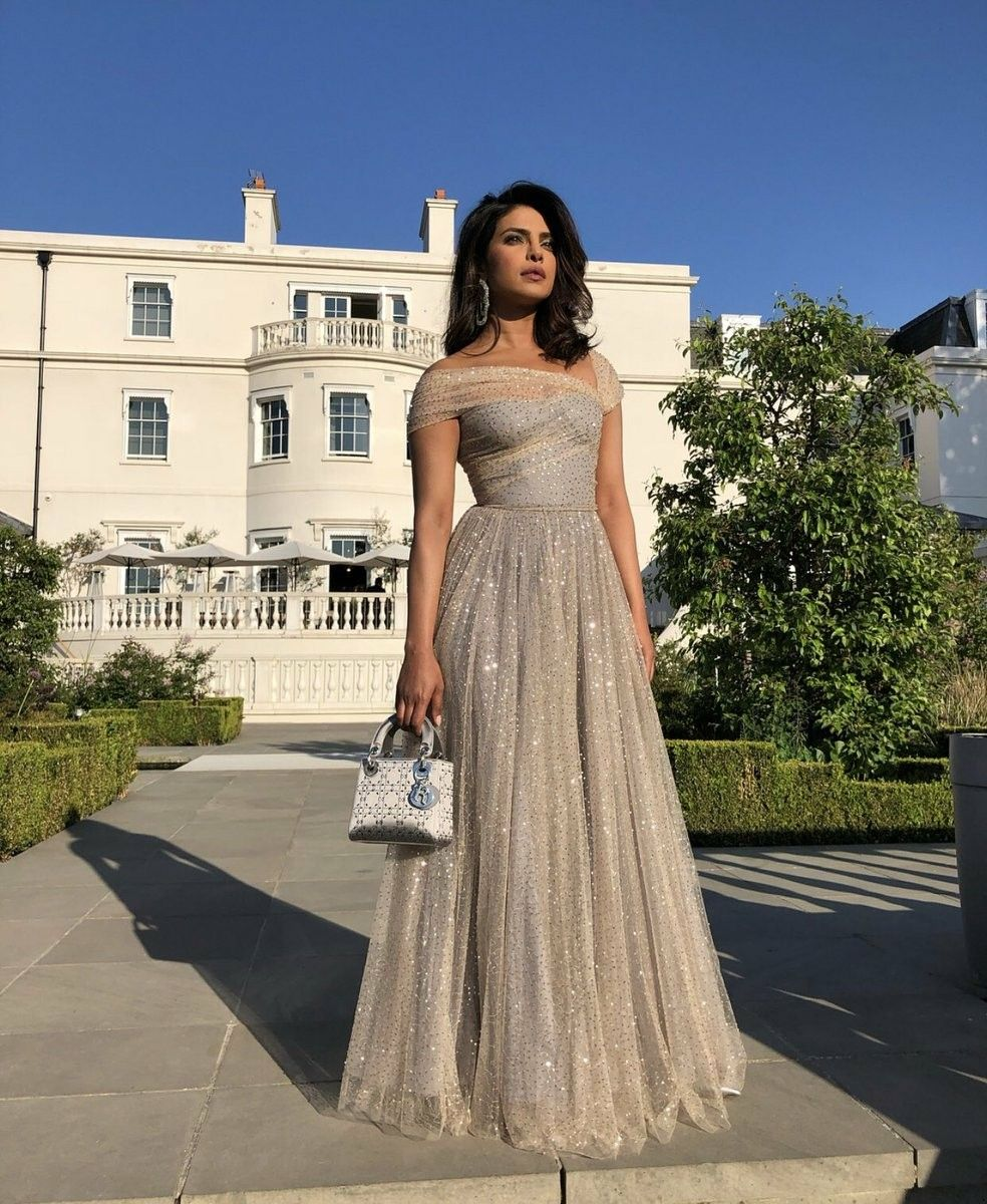 pc attends meghan markle prince harry wedding reception reception gown priyanka chopra wedding wedding reception outfit pc attends meghan markle prince harry