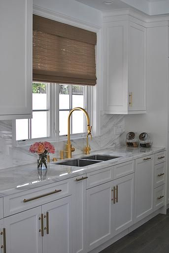 gorgeous kitchen outfitted with gold hardware white cabinets marble countertops and backsplash on kitchen remodel gold hardware id=79439