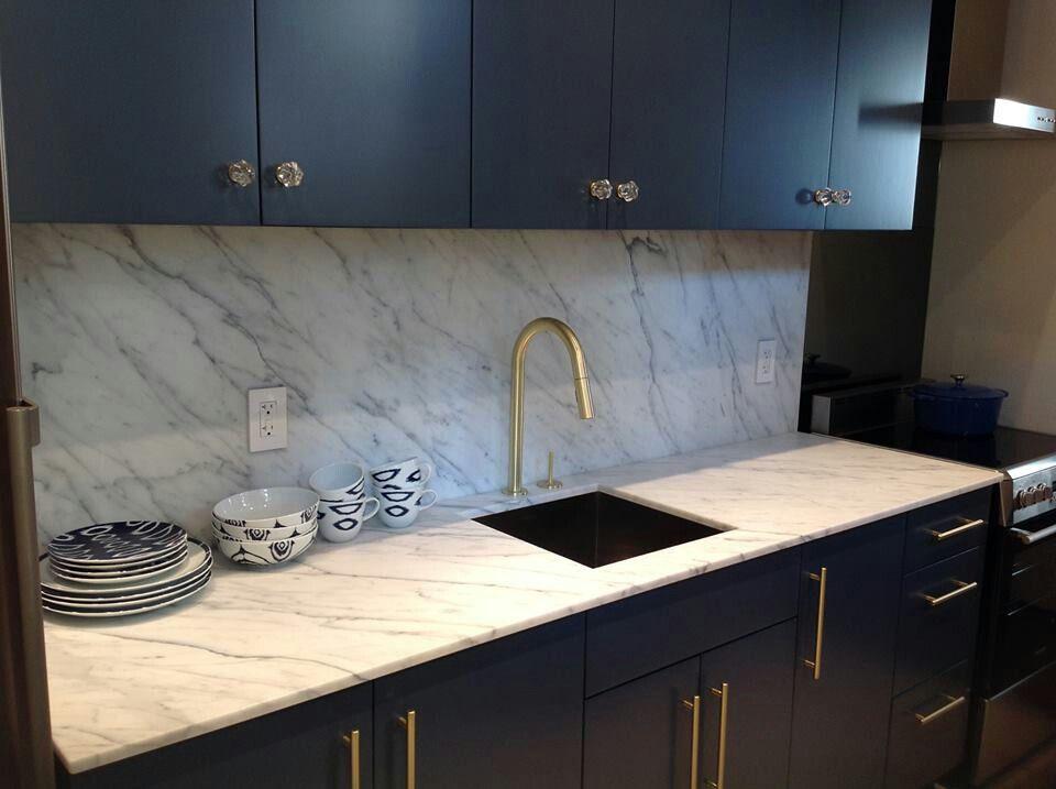 dark cabinets   white veined marble kitchens with