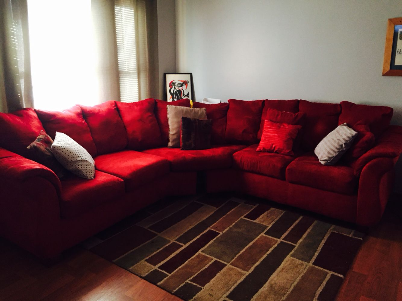 Red Sectional Grey Walls