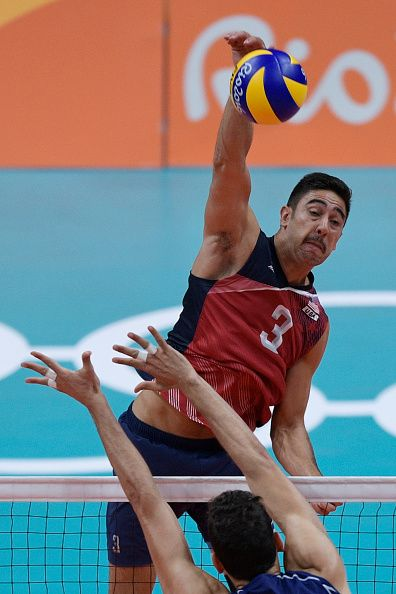 Usa S Taylor Sander Spikes The Ball During The Men S Semifinal Volleyball Match Volleyball Photography Usa Volleyball Team Mens Volleyball
