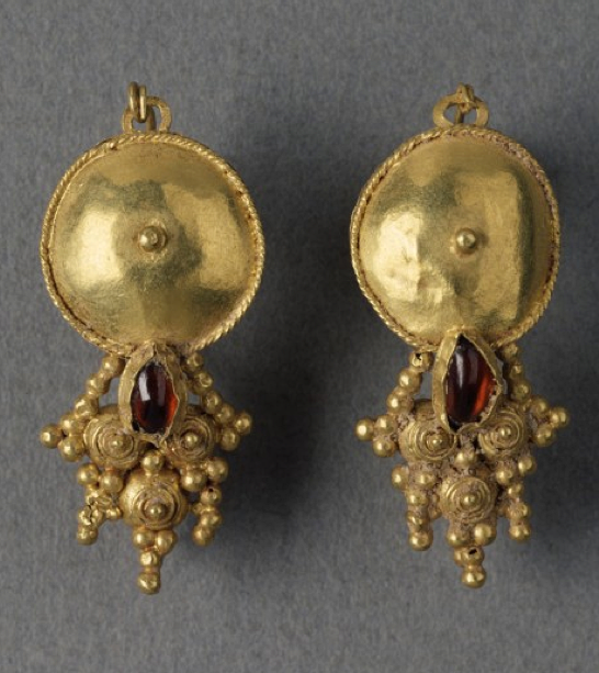 Pair of earrings is decorated with coarse filigree and granulation, Roman, 3rd century AD