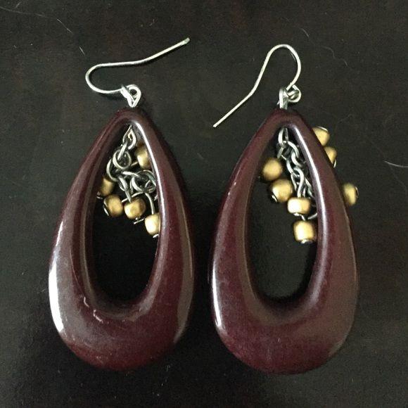 Brown dangle earrings Earrings are plastic. The hook is silver. Worn a few times. Jewelry Earrings