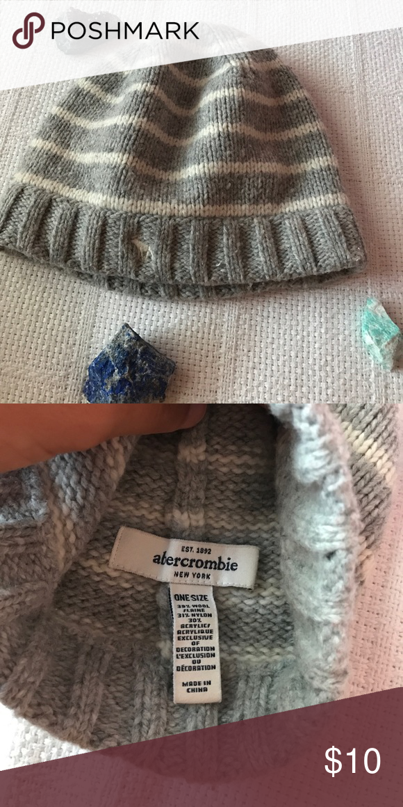 NWOT ABERCROMBIE & FITCH Wool Beanie !! This wool beanie is not needed here in South Florida 😂  it has a gray and white striped pattern, and has the Abercrombie logo on the front! Happy Poshing 💜💛💚 Abercrombie & Fitch Accessories Hats