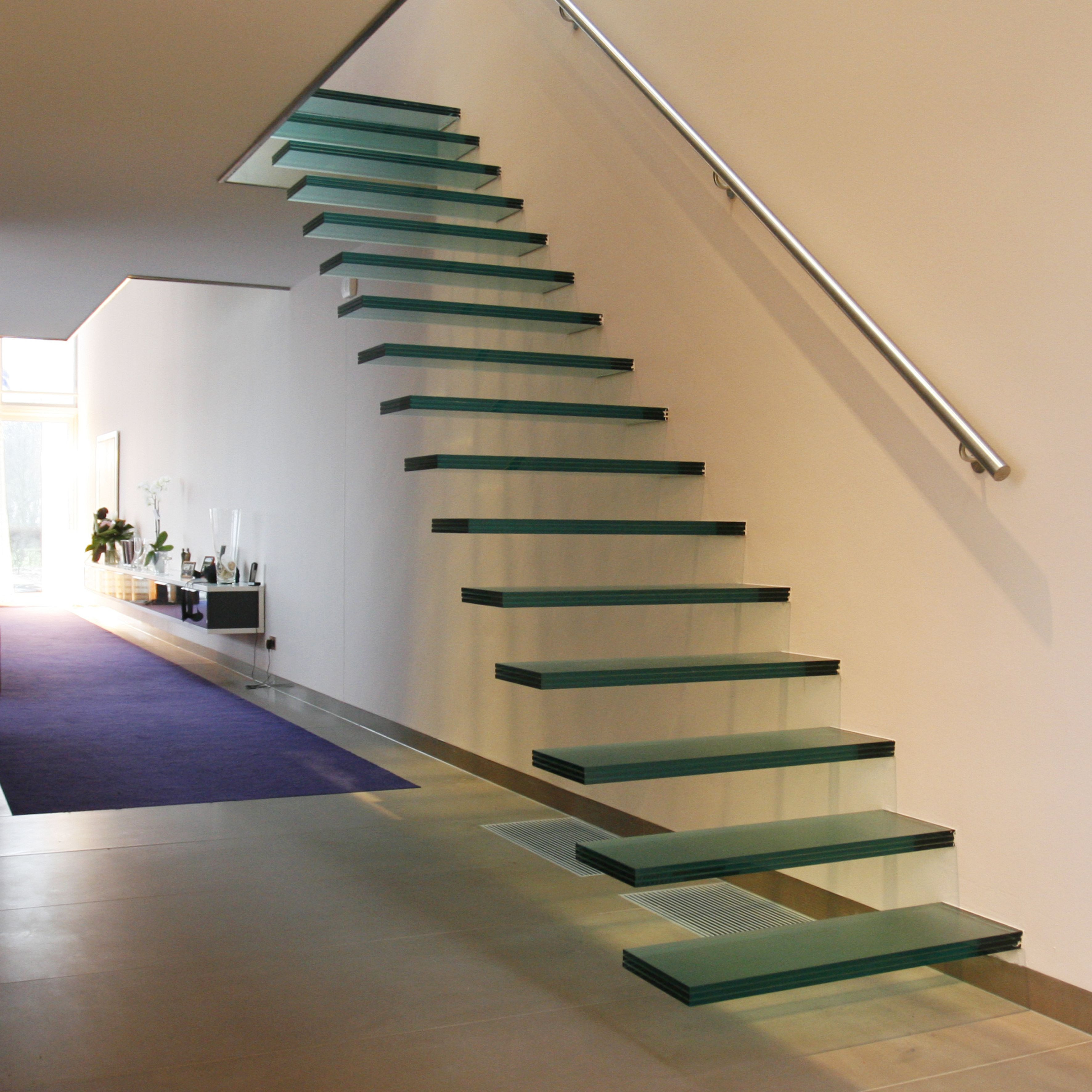 Floating Glass Staircase By EeStairs   Hidden Support System, With Stair  Treads Projecting Straight Out Of The Wall.