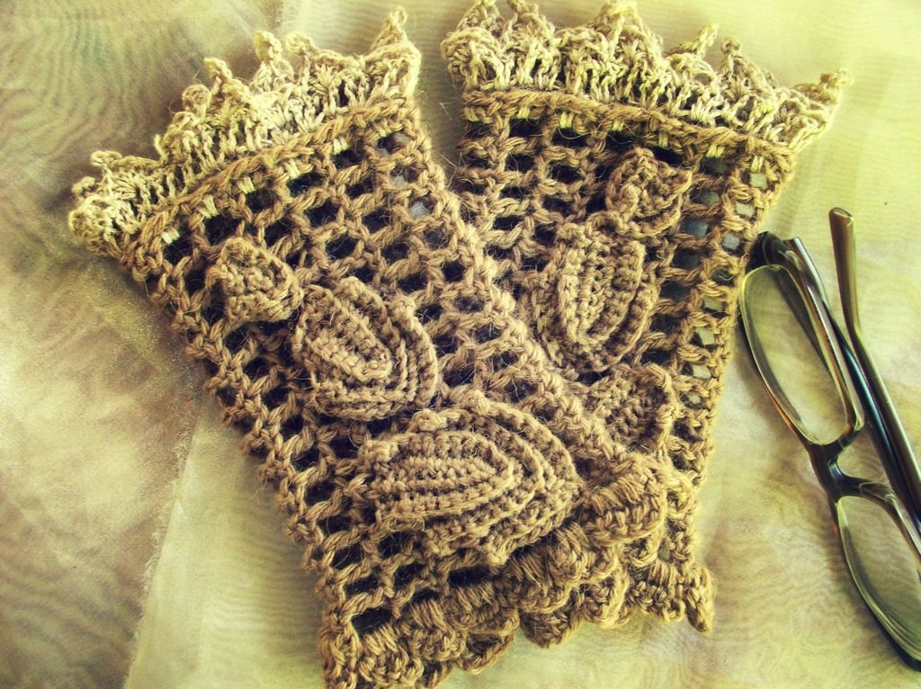 These Crocheted Wrist Warmers are done in baby camel yarn and a fine trim of silk-camel yarn. Irish crochet leaves decorate.