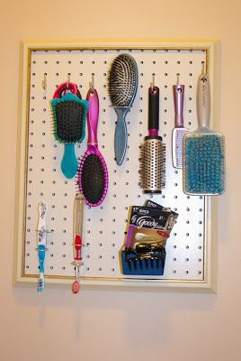 Pegboard in kids' bath to hold brushes.
