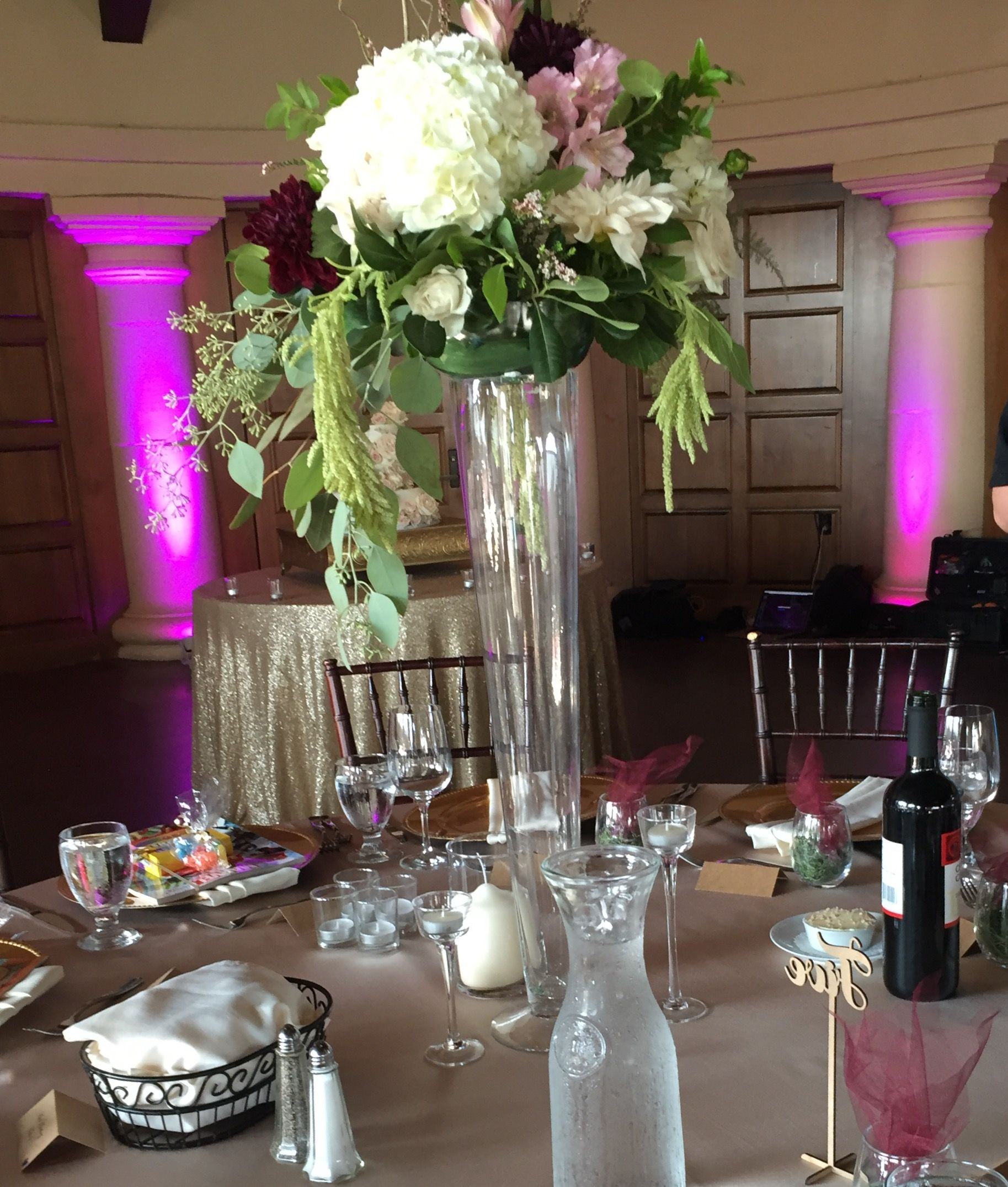 Tall Centerpiece In A Pilsner Vase With Hydrangea, Dahlias, Roses,