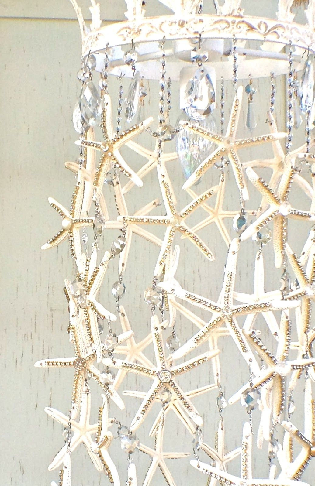 Starfish chandelier would be hard but could be a diy with some starfish and crystal chandelier tutorial debis design diary perfect for a mermaid bedroom or beach house diy and crafts arubaitofo Images