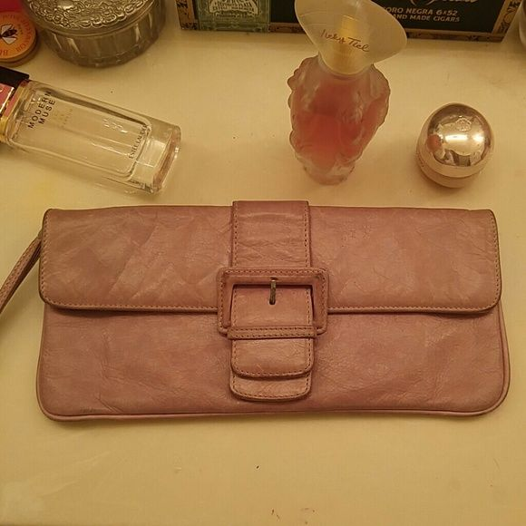 HOBO clutch Kind of a pinkish nude heavily distressed leather clutch or wallet by HOBO International.  Functionally in great condition.  As far as appearance, buckle is dirty on the edges and leather color has faded somewhat, but it's still an awesome clutch.  Has a strap for your wrist and the inside is clean too. HOBO Bags Clutches & Wristlets