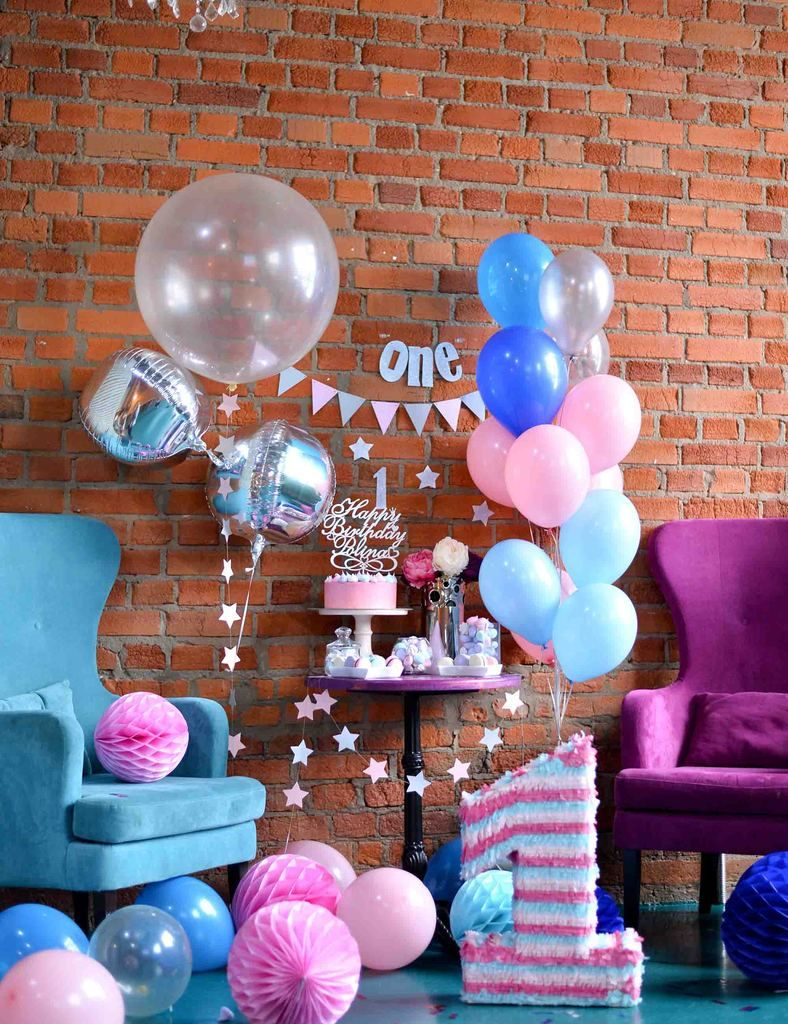 Birthday party for one year old with red brick backdrop