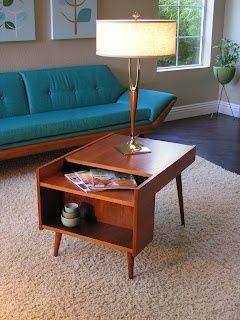 Elements of MID-CENTURY MODERN (1) minimalism - spare number of furniture pieces (2) medium-toned wood color (3) low profile sofa (4) simple coffee table with splayed legs plus small storage and display area - simplicity & functionality - hallmarks of the style. #midcenturymodern #midmod