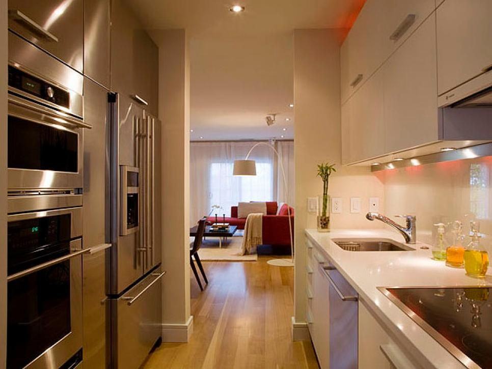 The galley, or corridor, kitchen has two straight runs on either side. Typically the sink is on one side and the range is on the other. The drawback to this design is traffic flow. A simple, one-wall design can be transformed into a galley shape with the addition of an island opposite the wall of cabinets. Islands help replace needed storage that is lost in an open kitchen design with limited wall cabinets.