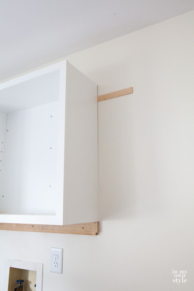 How to hang wall cabinets in a laundry room | Home Is ...