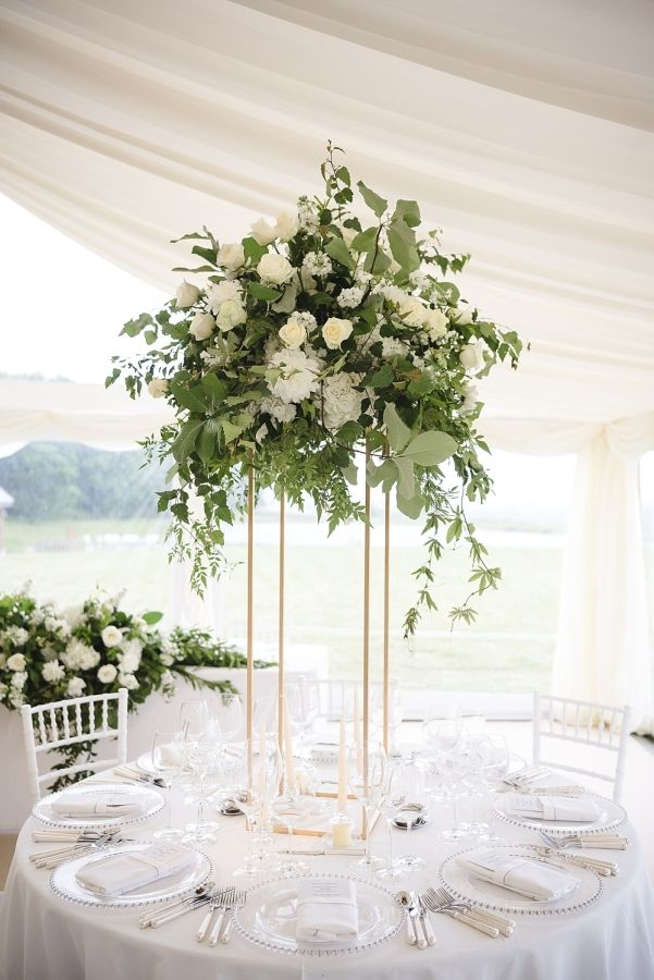 Eucalyptus and olive branch centerpieces: http://www.stylemepretty.com/little-black-book-blog/2016/10/31/elegant-at-home-british-wedding/ Photography: Weddings by Nicola & Glen - http://www.weddingsbynicolaandglen.com/