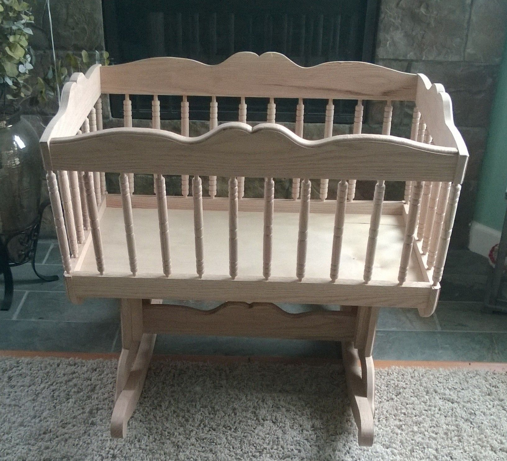 Handcrafted rocking cradle made from solid red oak 34 hand turned spindles