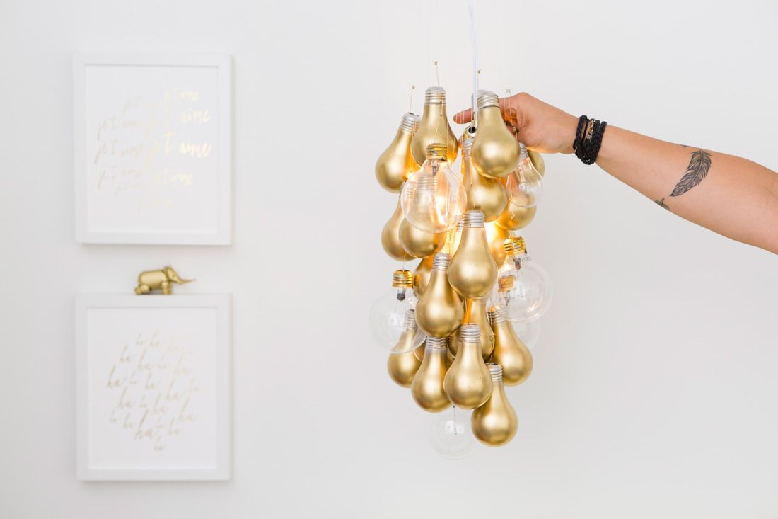 You can totally diy this gold dipped light bulb chandelier light you can totally diy this gold dipped light bulb chandelier via brit co arubaitofo Image collections