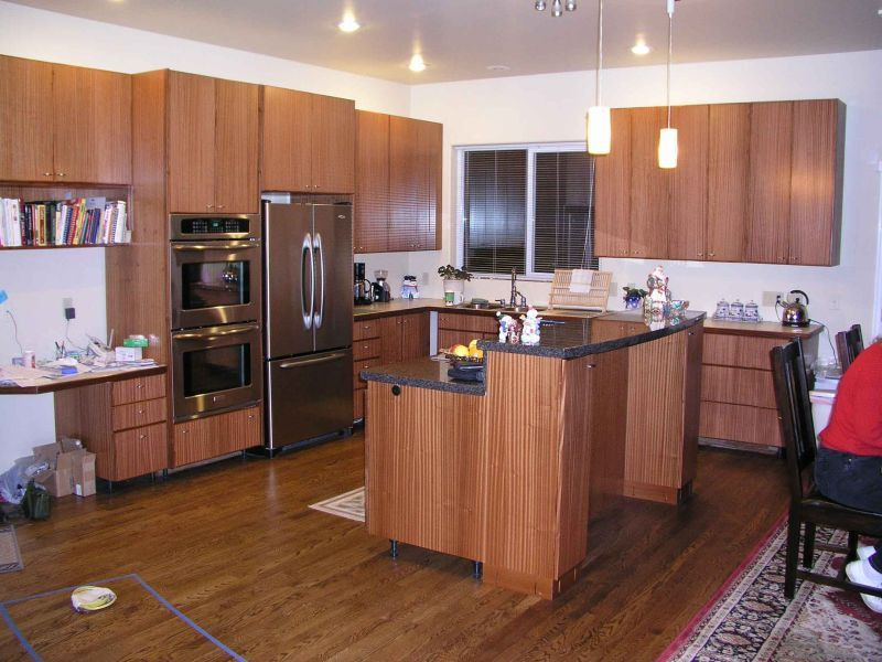 Ribbon Sapele Cabinets Things To Consider With Sapele Wood Cabinets Sapele Darkens Over Time It Goes To A Rich Brown Wi Sapele Home Kitchens Kitchen Storage