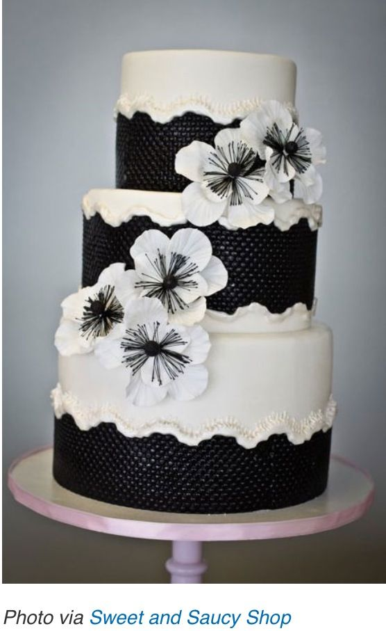 Black and white textured cake with poppies