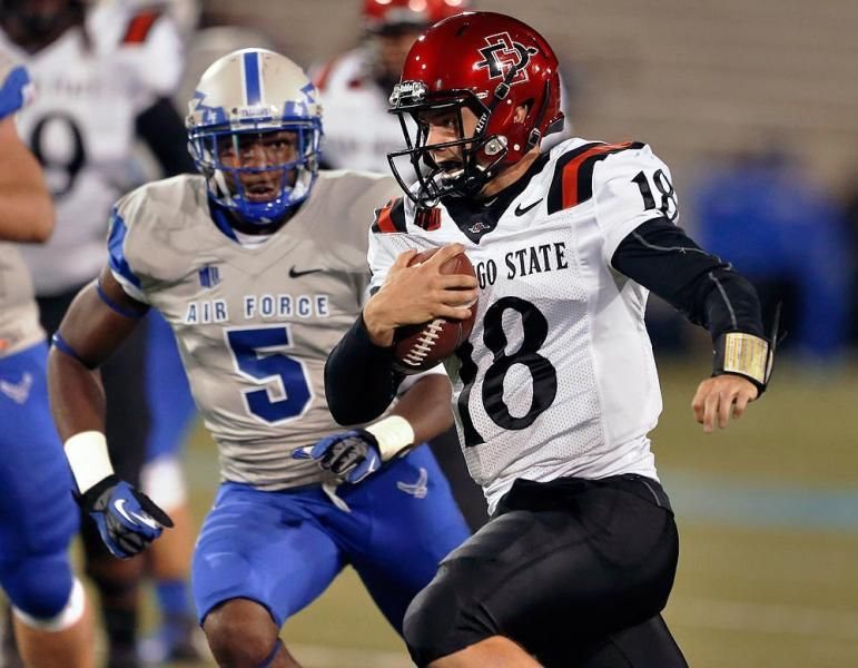 San Diego State quarterback Quinn Kaehler runs with the ball pursued by Air Force defensive back Dexter Walker