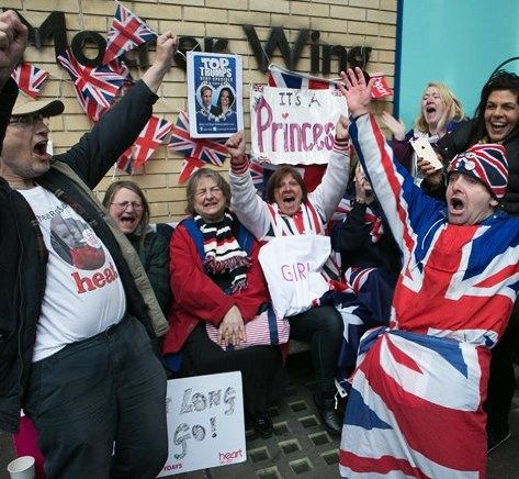 Fans celebrate outside St Mary's Hospital In pictures: Celebrating the birth of the royal baby