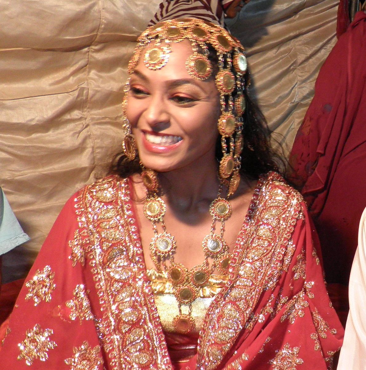 Nubian Bride Dressed In The Traditional Red And Gold