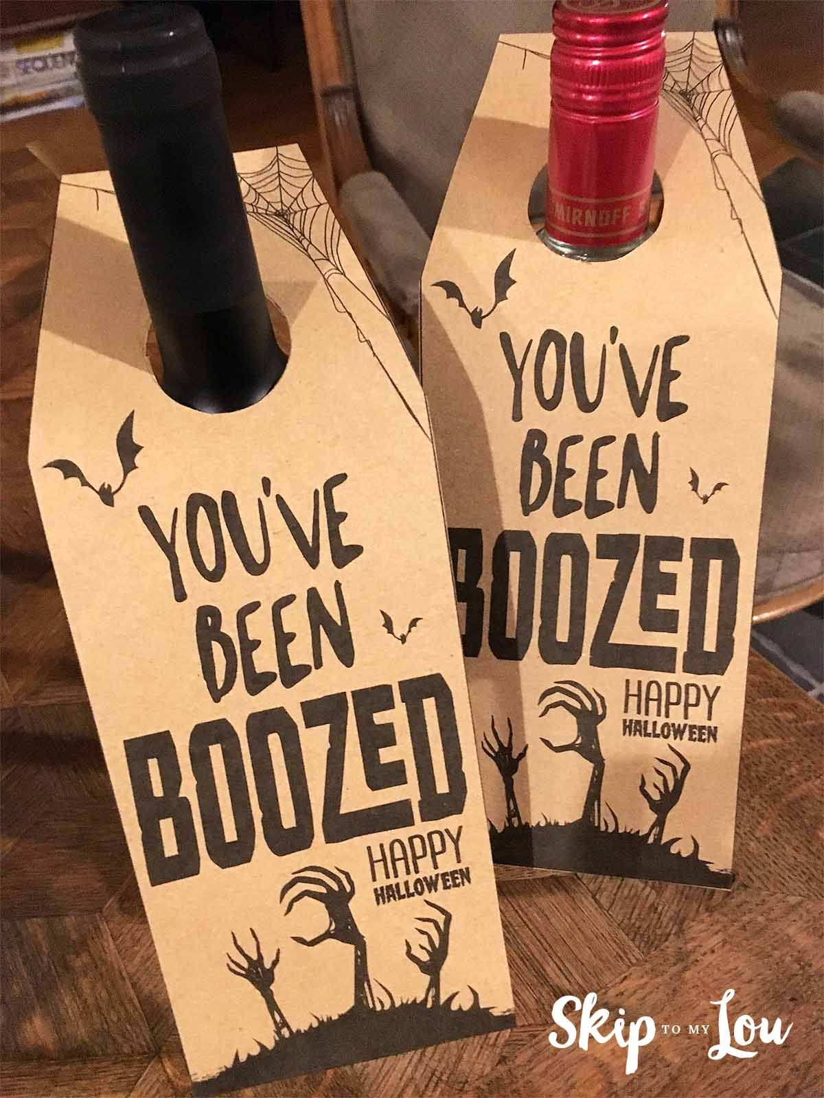 """""""Booze"""" your friends this Halloween! Why let kids have all the fun? Print this free label, hang from your bottle of wine, and go boo your adult friends this Halloween. #halloween #boo"""