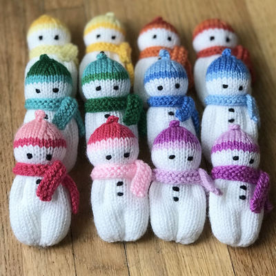 These ornaments are re-sized and adapted from the Izzy Doll patterns available freely online for charity knitting. The pattern is free for personal use, not for sale or profit. #knitteddollpatterns