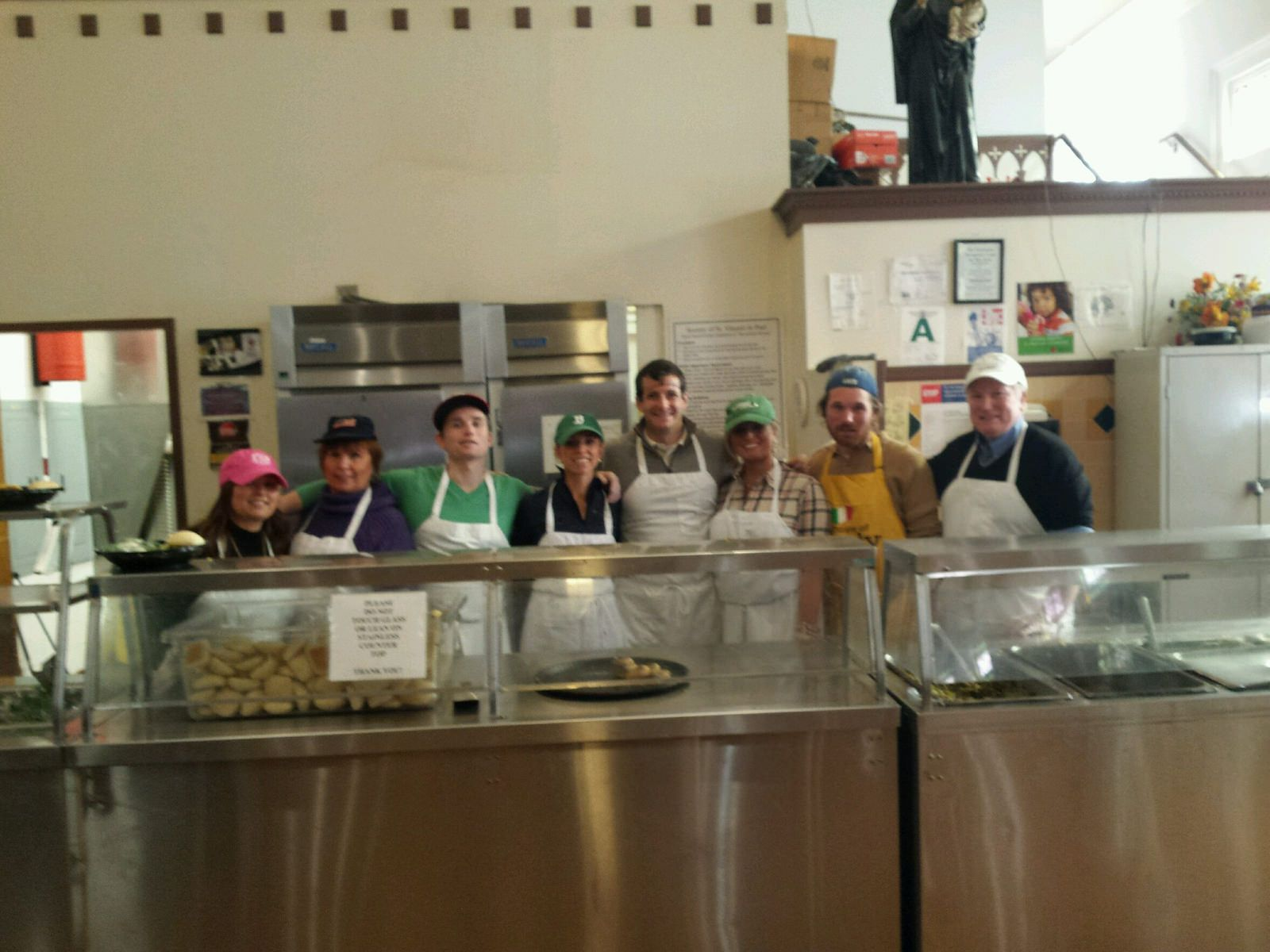 Volunteers preparing to serve fresh hot meals to the