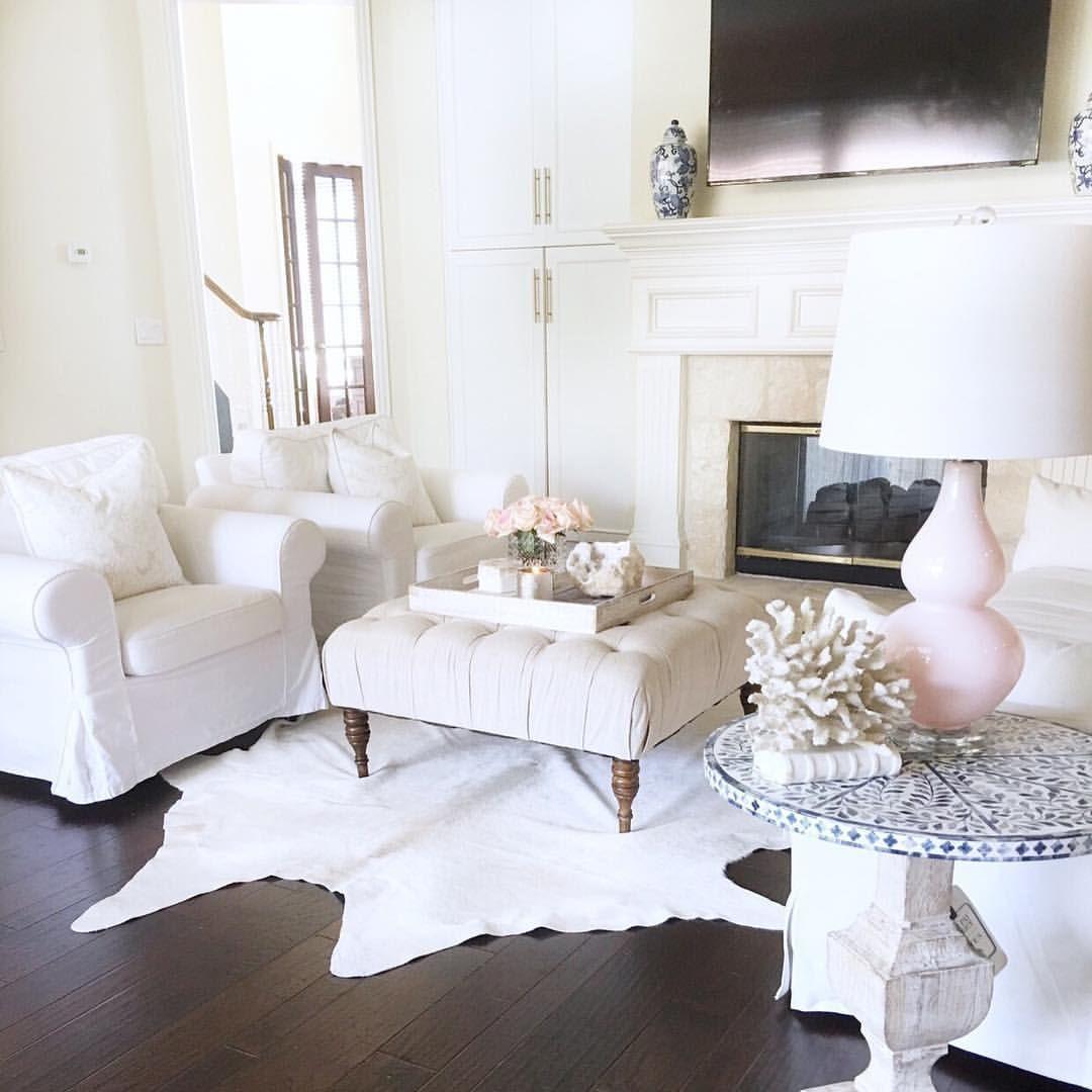 Blush pink decor. Wood floors. Cowhide rug. White living room. White ...