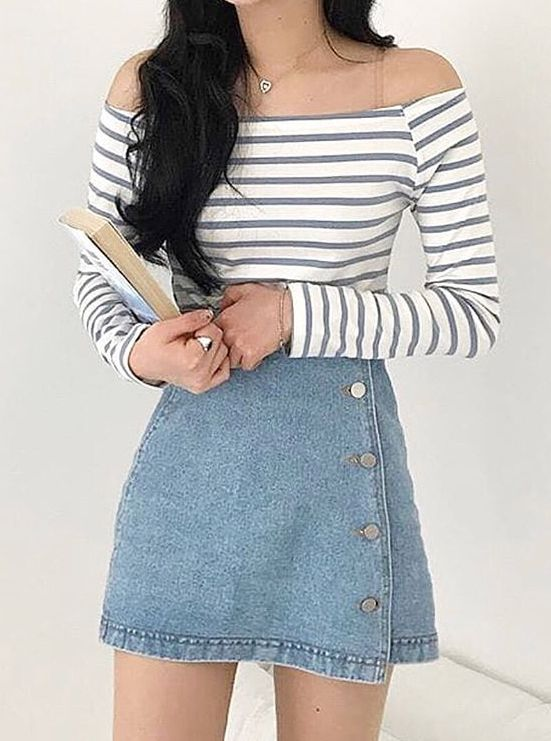 Photo of Beautiful look from striped sweater shoulder to shoulder and denim skirt