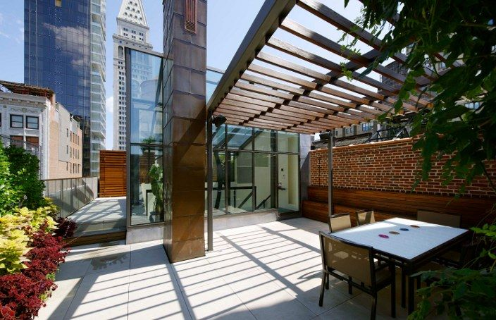Modern Roof Deck In New York City With Ipe And Steel Trellis, Stone Pavers,