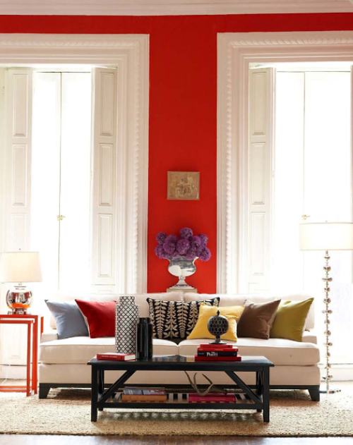 Red Walls. White Couch. Lots of Color.