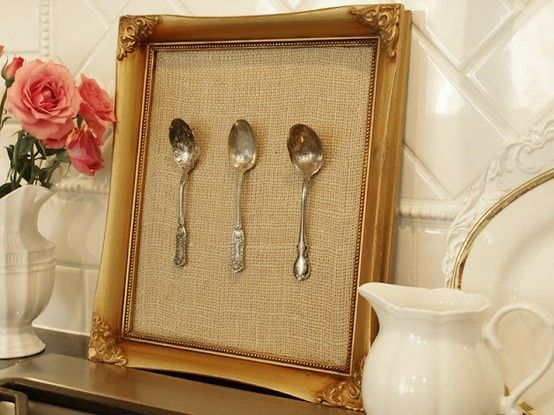 A simple but effective way to display a collection of silver / silver-plated spoons. Find a vintage frame, back it hessian fabric, use transparent plastic thread (can buy this is sewing stores/departments) and a large needle to tie the spoons to the fabric. Et Voila!  (Let the natural patina develop or use a deeper frame with glass cover to keep the shine for longer. And keep away from direct sunlight). Repinned by www.silver-and-grey.com